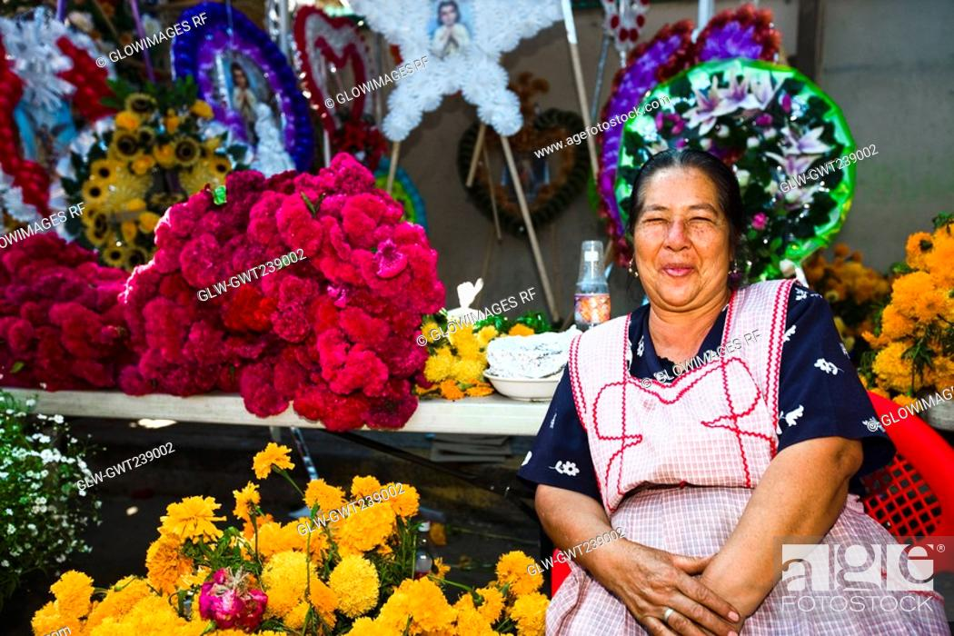 Stock Photo: Senior woman selling flowers, San Juan Nuevo, Michoacan State, Mexico.
