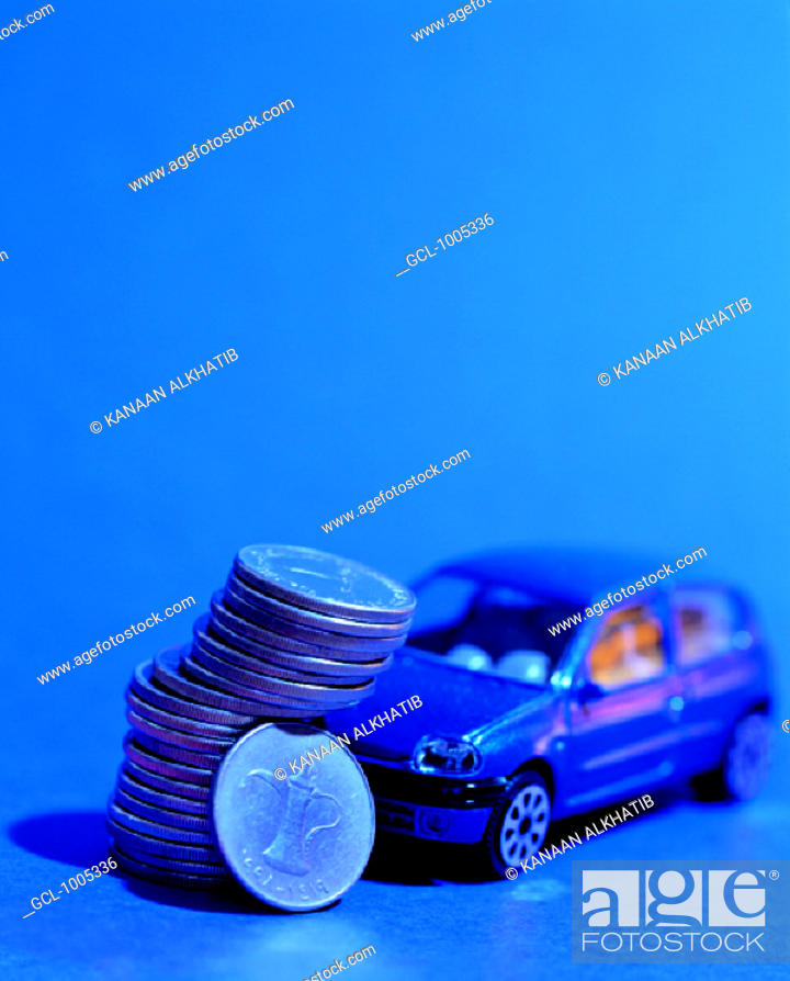 Stock Photo: Pile of UAE coins and toy car.