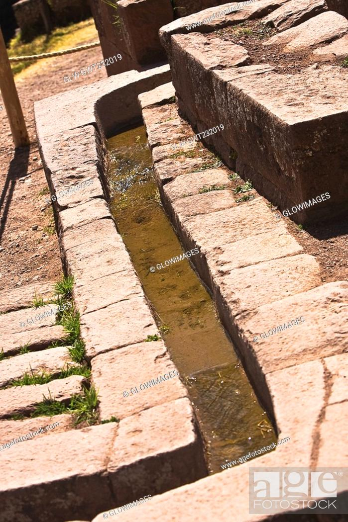 Stock Photo: Water flowing through a stone's drain, Pisaq, Urubamba Valley, Peru.