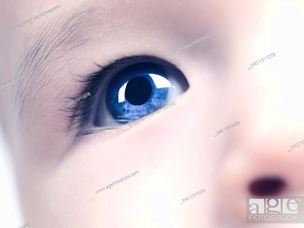 Stock Photo: Closeup of a blue eye of a six month old baby boy  Digitally altered.