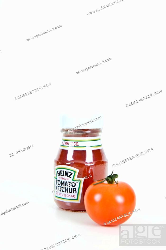 Stock Photo: bottle of ketchup and cherry tomato.