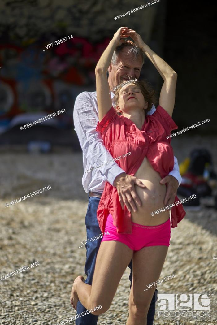 Stock Photo: Sensual couple, pregnancy, romantic, age difference, love. Munich, Germany.