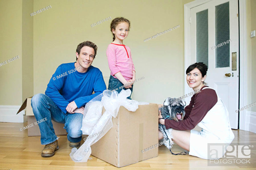 Stock Photo: Family and dog in new house.