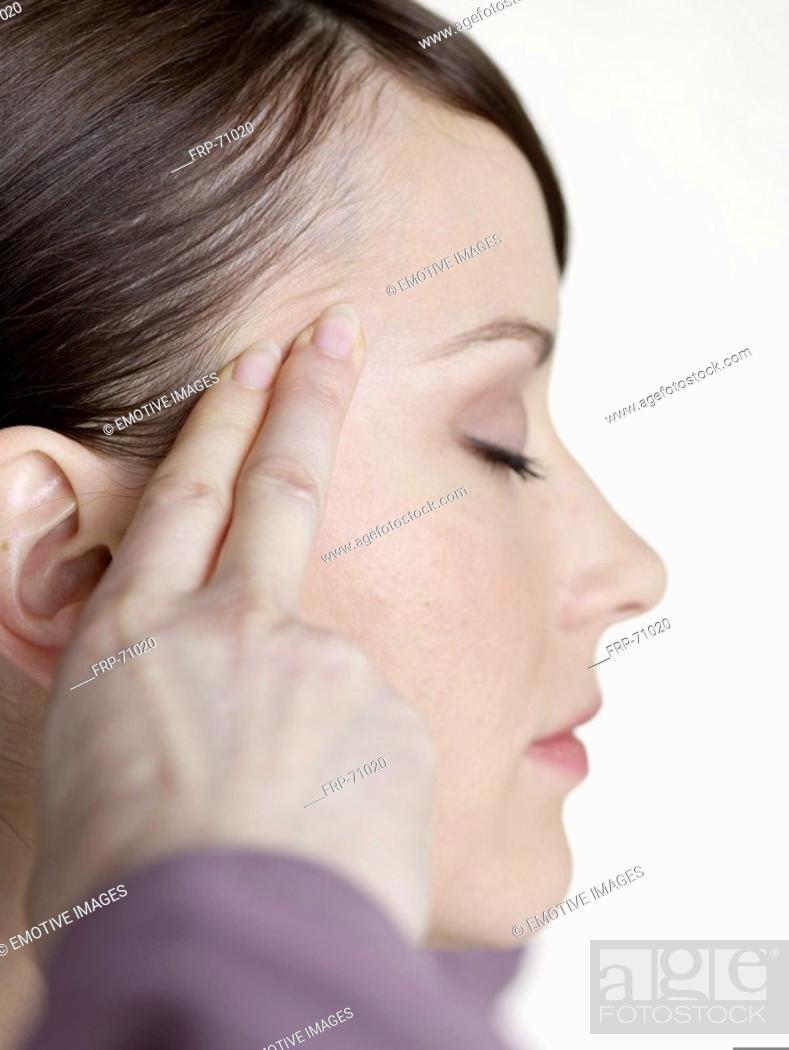 Stock Photo: massage againt headache.