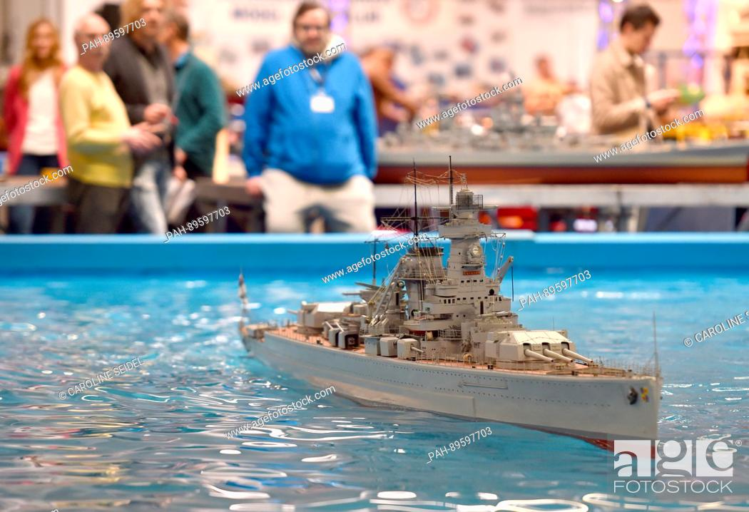 Stock Photo: A model of the German armored ship 'Graf Spee' floating in water at the Modellbau trade show, Intermodellbau, in Dortmund, Germany, 04 April 2017.