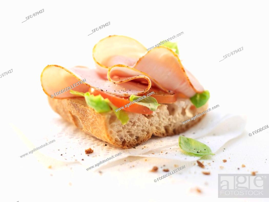 Stock Photo: Smoked chicken breast on baguette.