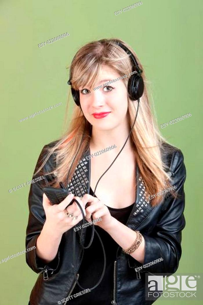Stock Photo: Teen Listens To Music.