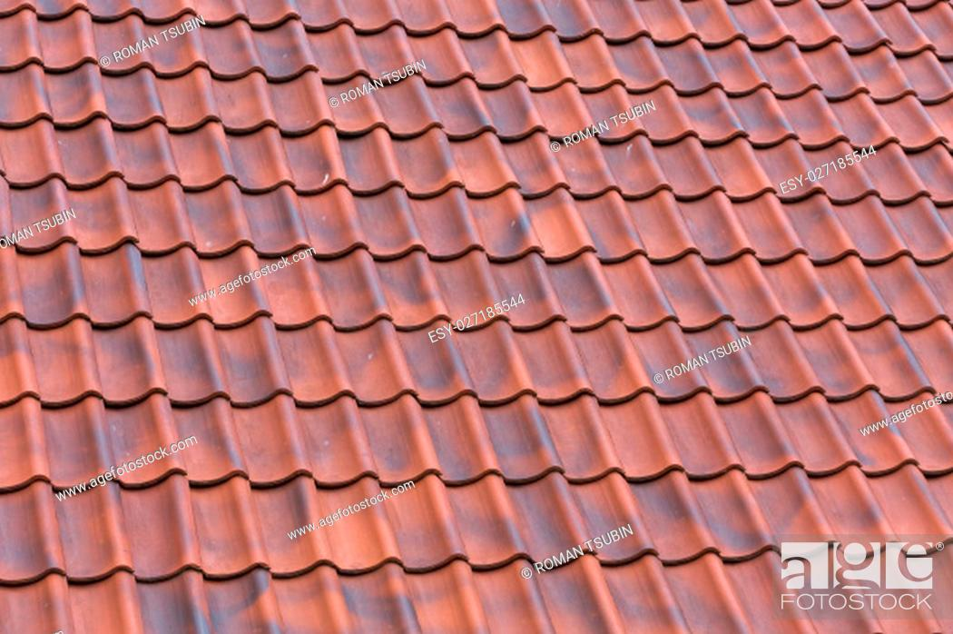 Stock Photo: Red tiles roof background texture of a house.
