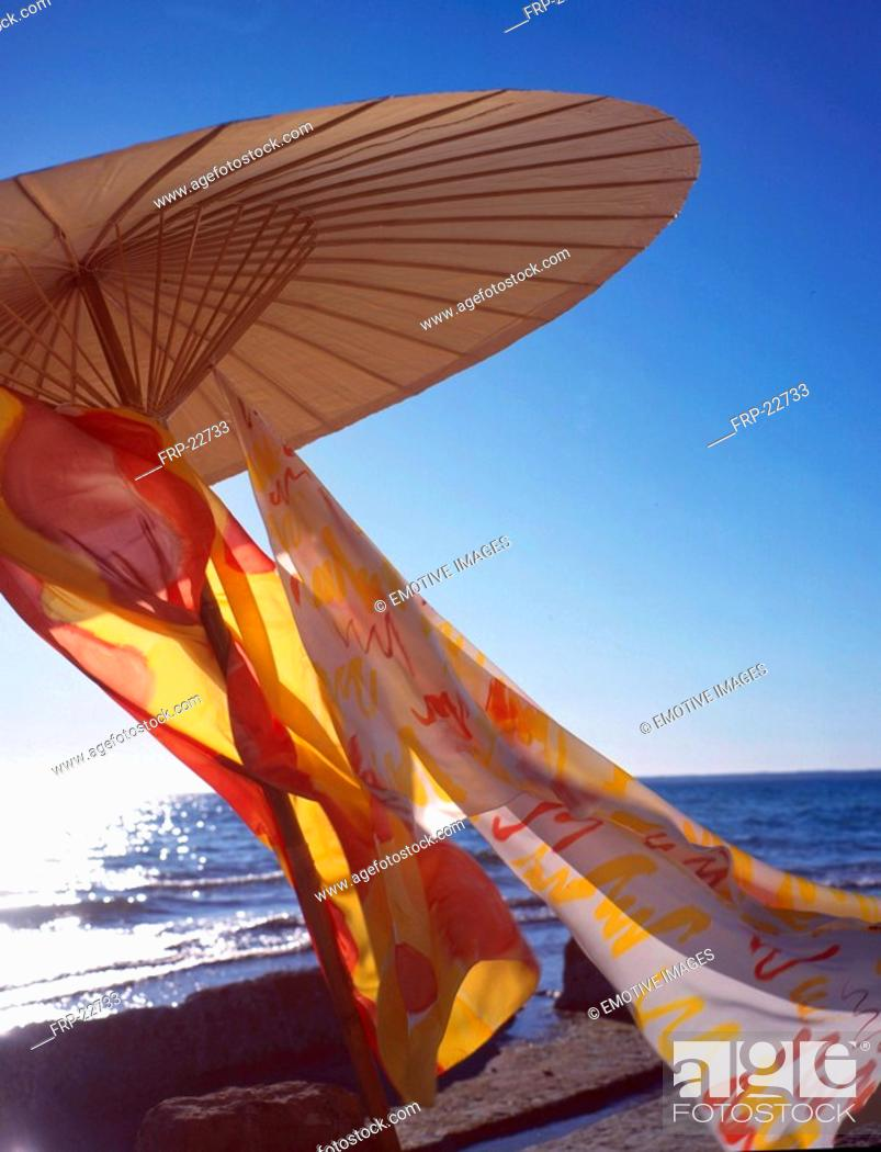 Stock Photo: Parasol with colourful scarves.