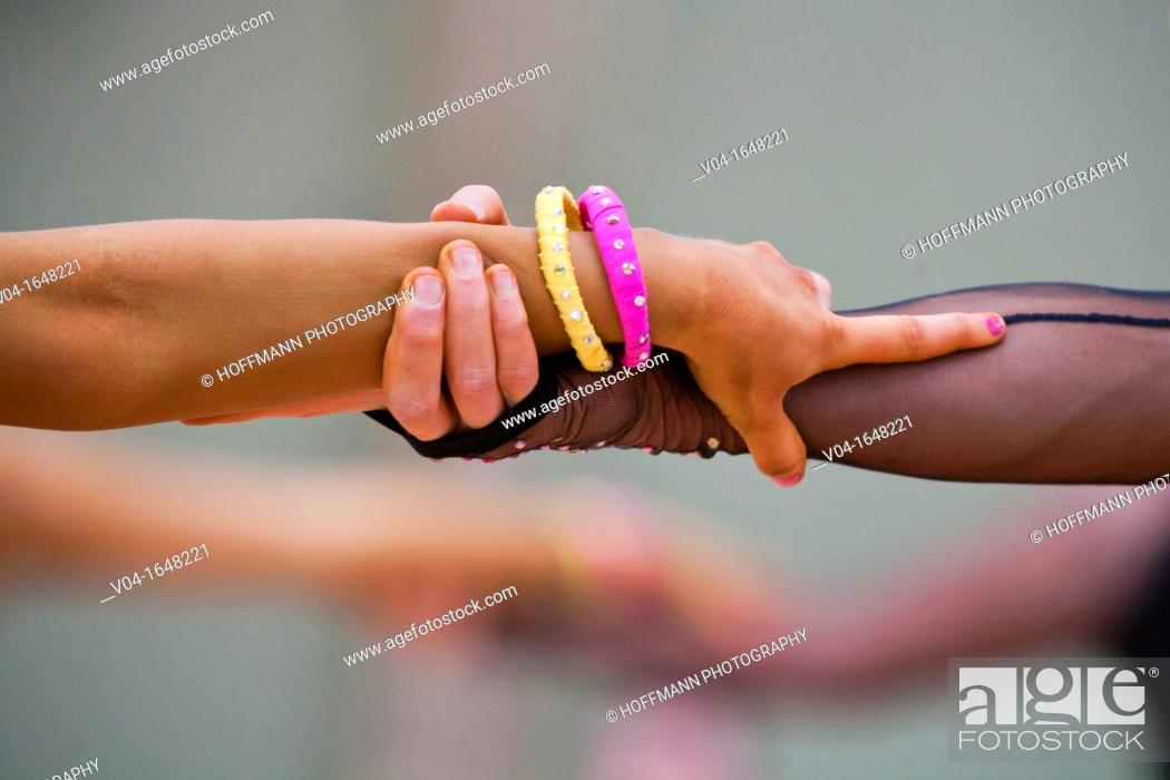 Stock Photo: Couple holding hands at a dancing competition in Germany, Europe.