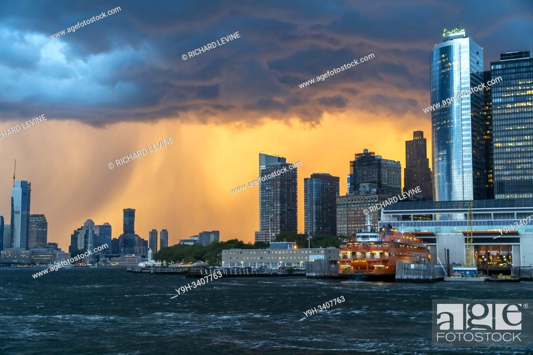 Stock Photo: The Staten Island Ferry docks at the Battery Terminal on Thursday, August 8, 2019 prior to the arrival of a summer storm.