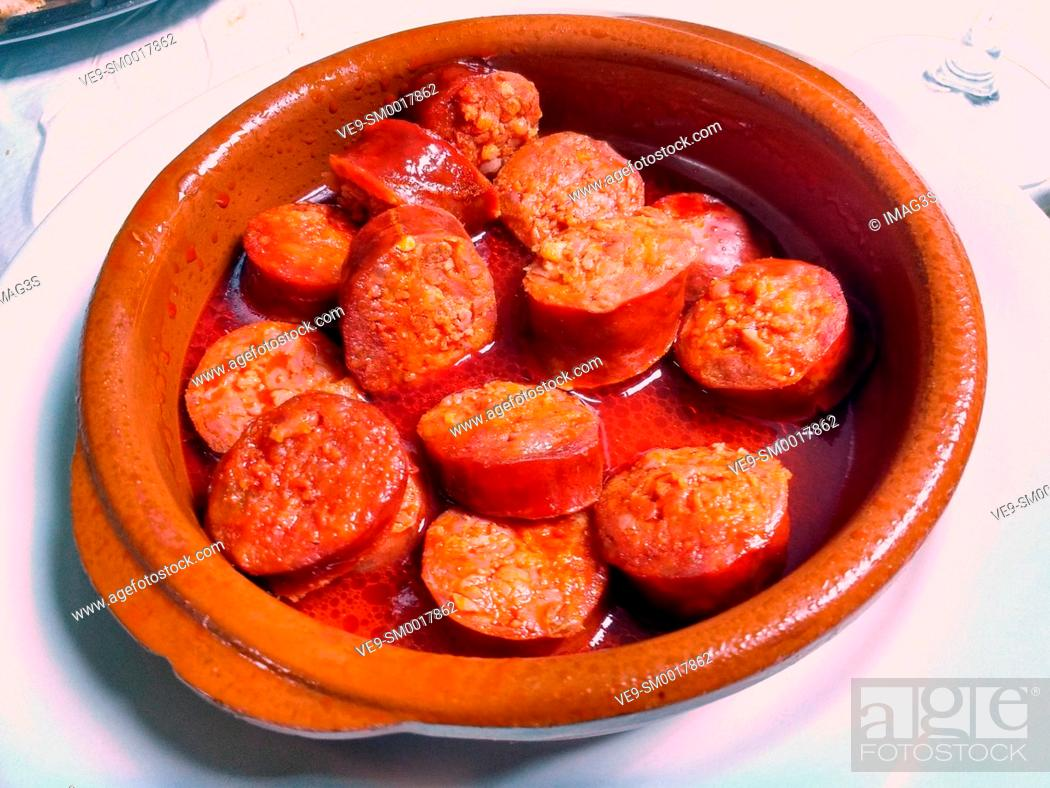 Stock Photo: Chorizo a la sidra (red sausage cooked with cider), Nava, Asturias, Spain.