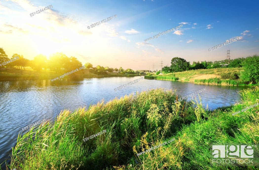 Stock Photo: Bright sunset over calm river in summer.