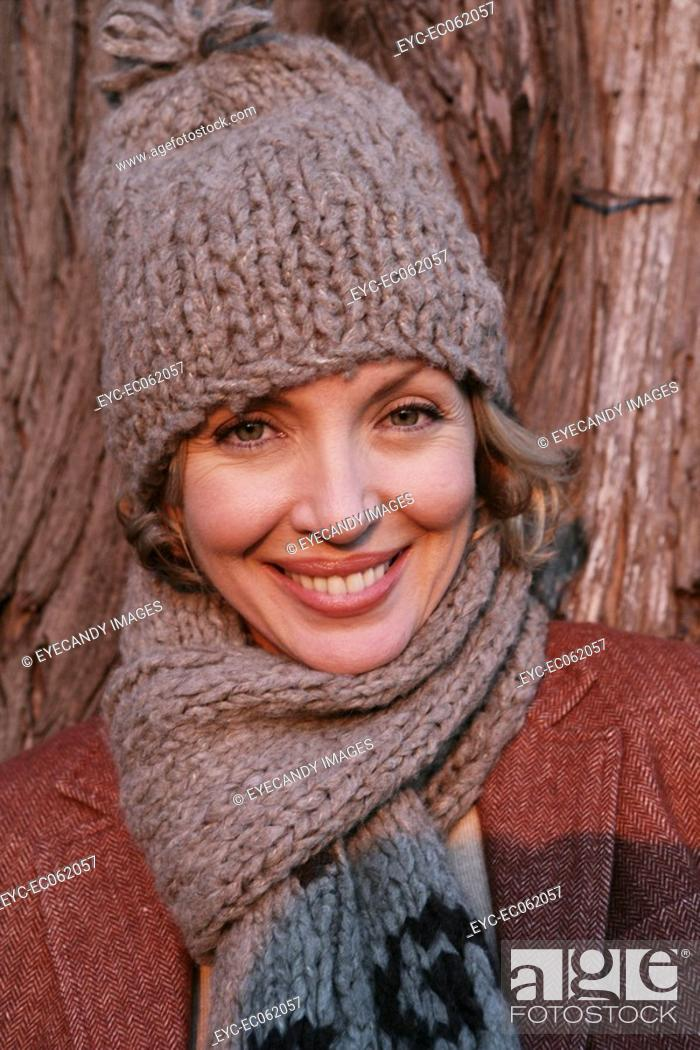 Stock Photo: Mature woman wearing a hat and scarf.