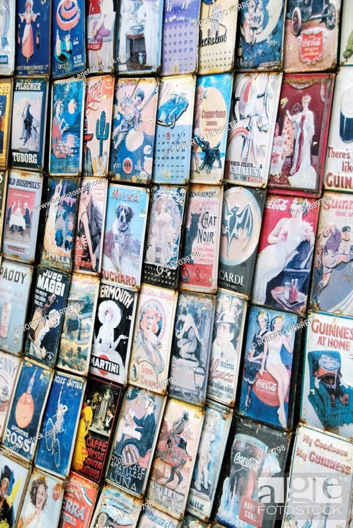 Stock Photo: Old tin advertisements in tourist souvenir shop.