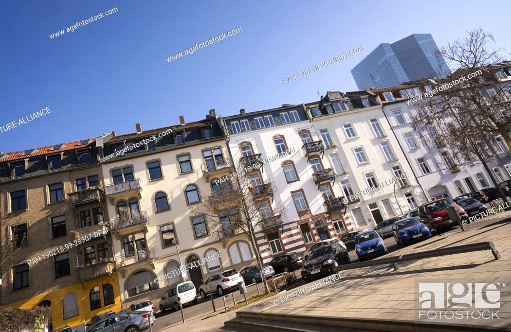 Stock Photo: 15 February 2019, Hessen, Frankfurt/Main: Within sight of the headquarters of the European Central Bank (ECB, r) there are houses in Rückertstraße in the east.