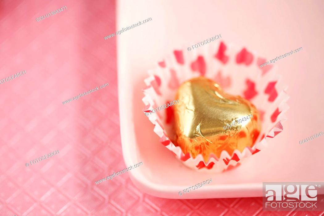 Stock Photo: Single chocolate on plate (close-up).