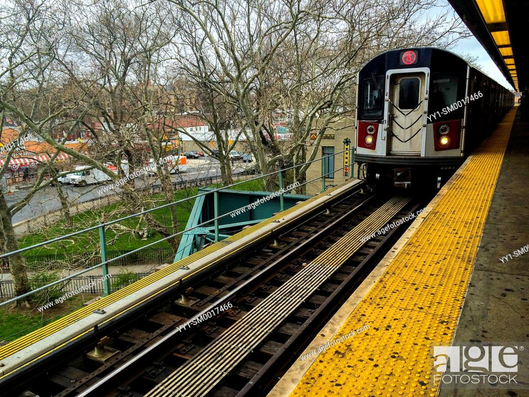 Stock Photo: New york City, USA. Subway train arriving at an elevated subway train station in Brooklyn.