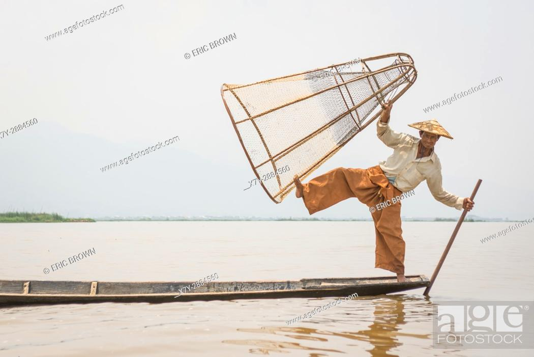 Stock Photo: A fisherman poses for a photo. Inle Lake, Myanmar.