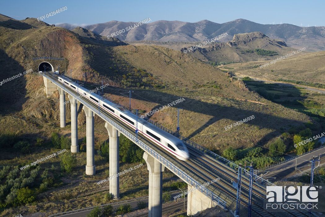 Stock Photo: view of a high-speed train crossing a viaduct in Purroy, Zaragoza, Aragon, Spain. AVE Madrid Barcelona.
