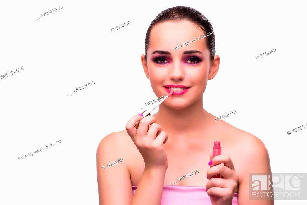 Imagen: Woman applying lipstick isolated on white.