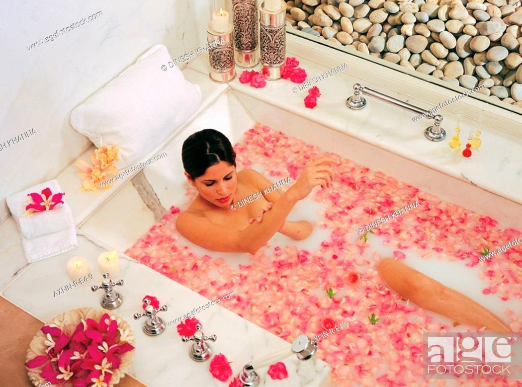 Woman having a Goat\'s milk soak in tub at Spa in Oberoi\'s Raj Vilas ...