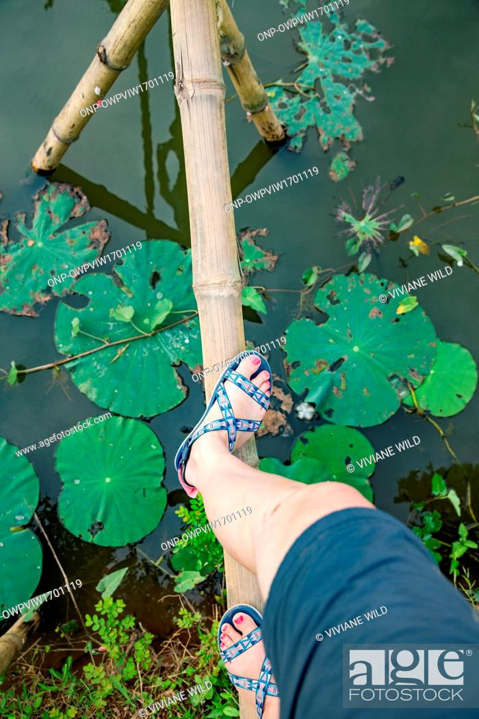 Stock Photo: (C?n Son, Bii H?u Nghia,) near C?n Tho, the largest city in the Mekong Delta and the capital of the Mekong Delta, Running on a land monkey bridge.