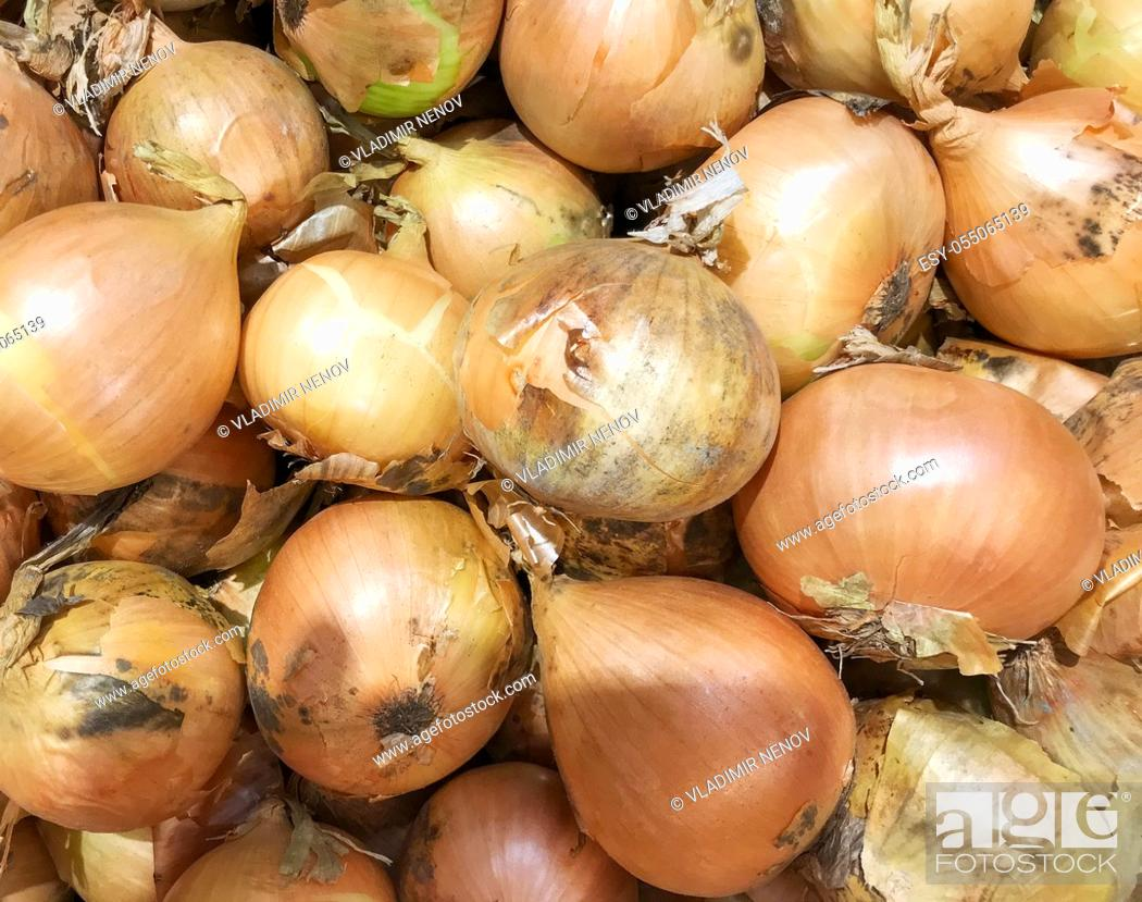 Stock Photo: Close-Up Of Dry Onions Background.