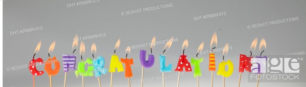 Stock Photo: Candle Letters lit up and spelling out congratulations.