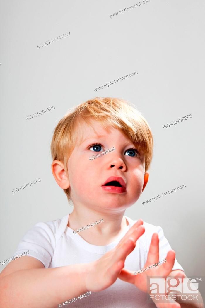 Stock Photo: Boy gesturing with hands.