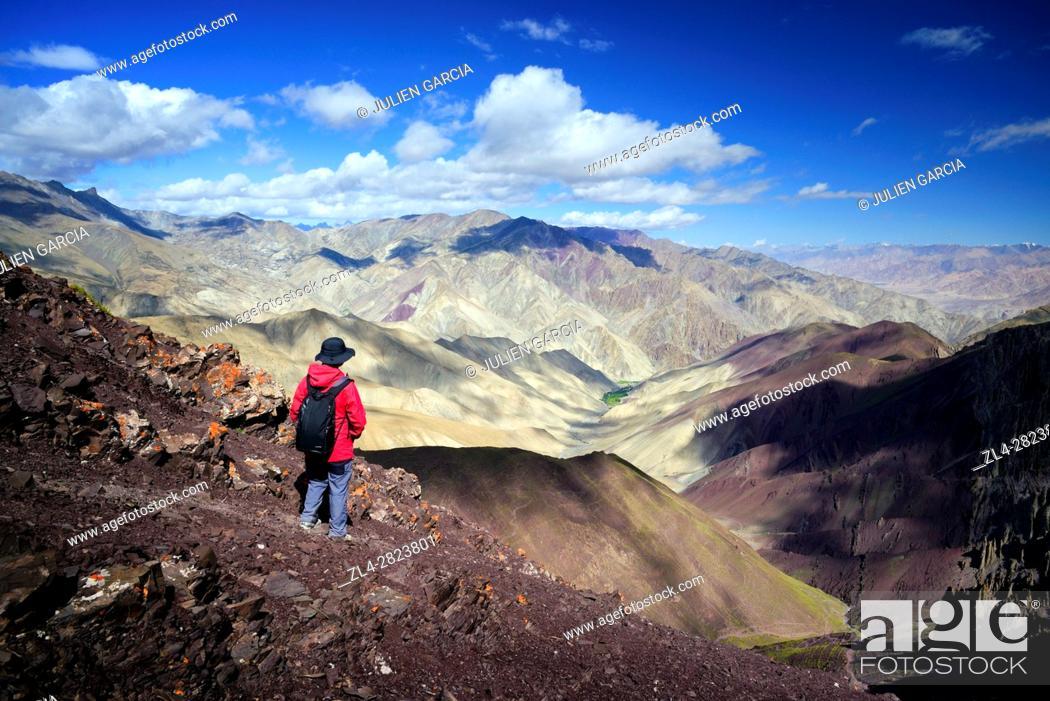 Stock Photo: India, Jammu and Kashmir State, Himalaya, Ladakh, Hemis National Park, hiker at the Stok La pass (4850m) looking towards the Rumbak valley, Model Released.