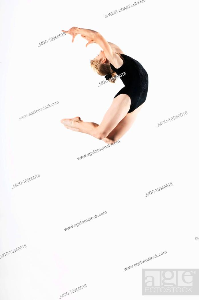 Stock Photo: Gymnast 16-17 leaping in air side view.