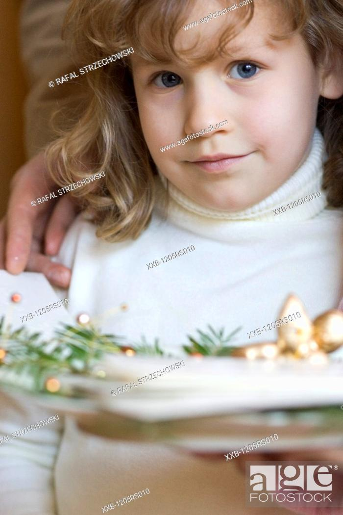 Stock Photo: girl holding plate with wafer.