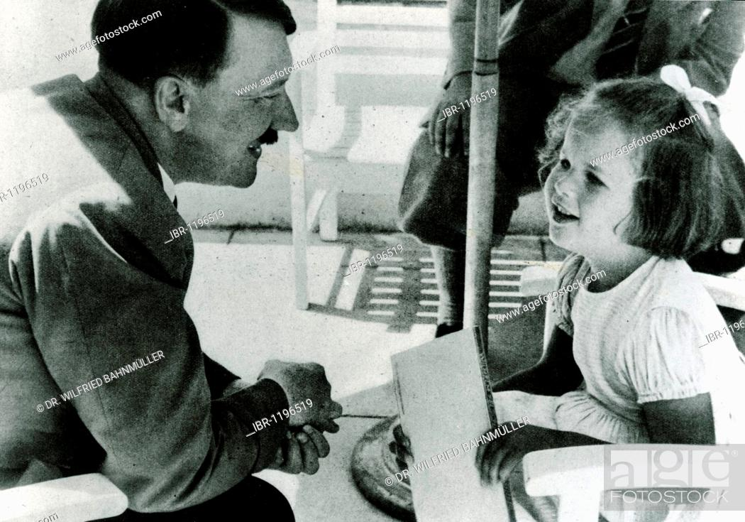Stock Photo: Adolf Hitler talking with a girl, historical photo circa 1937.