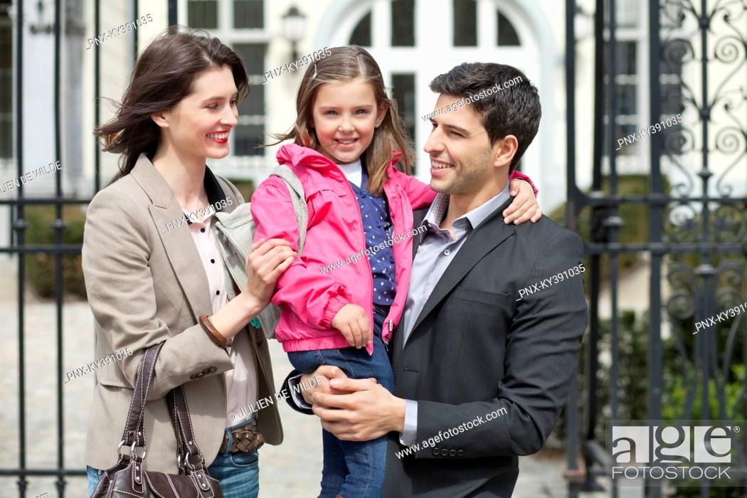 Stock Photo: Close-up of a girl with her parents.