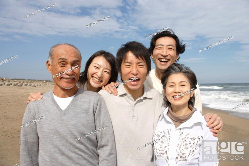 Stock Photo: Family at beach smiling, portrait.