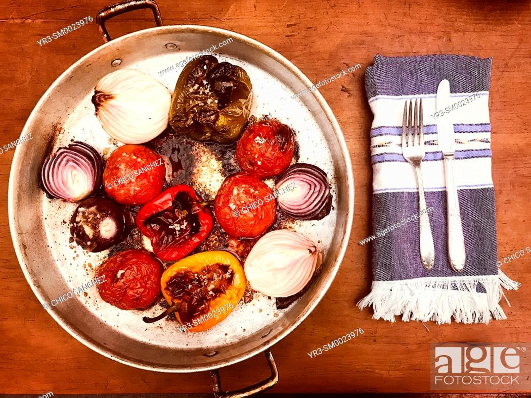 Stock Photo: Baked vegetables and a napkin, a fork and a knife in a home in Colonia Roma, Mexico City, Mexico.