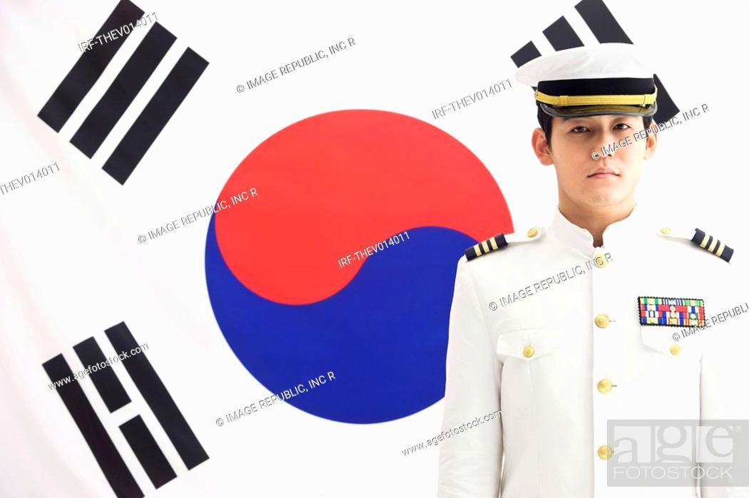 Stock Photo: navy in front of Korean flag, Taegeukgi.
