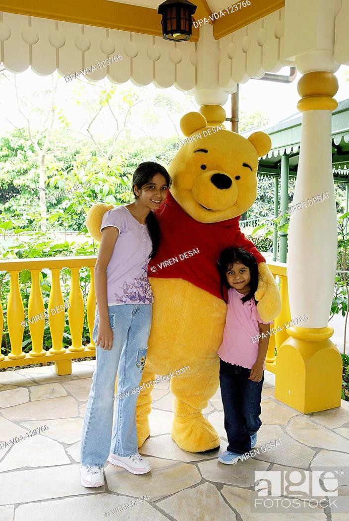 Stock Photo: Girls portrait with Winnie Pooh at Hong Kong Disneyland ; Hong Kong MR477.