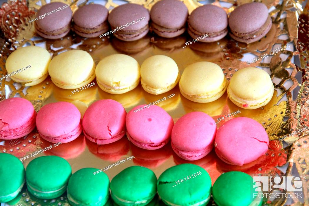 Stock Photo: Macarons on a golden tray.