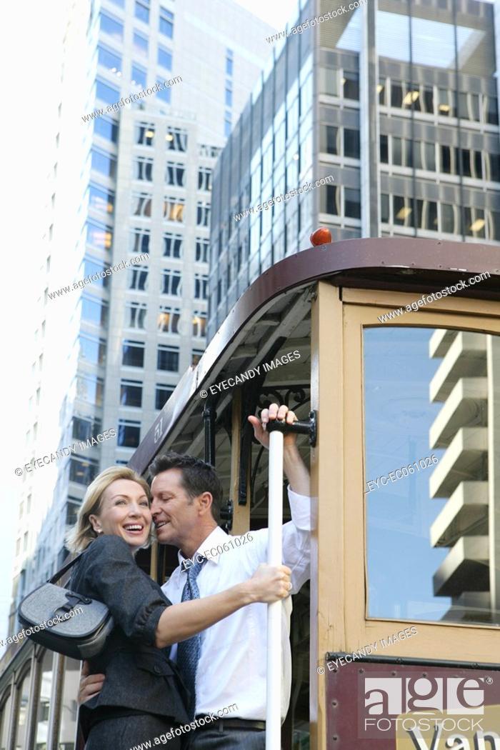 Stock Photo: Mature couple riding a street car.