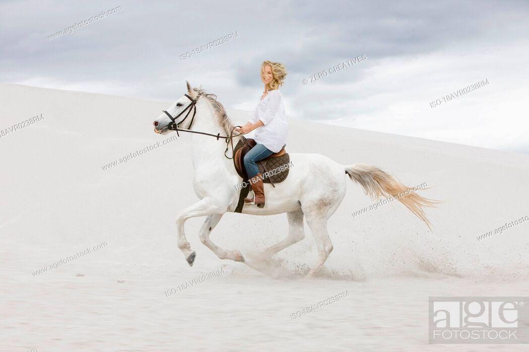 Stock Photo: Horseriding on the beach.