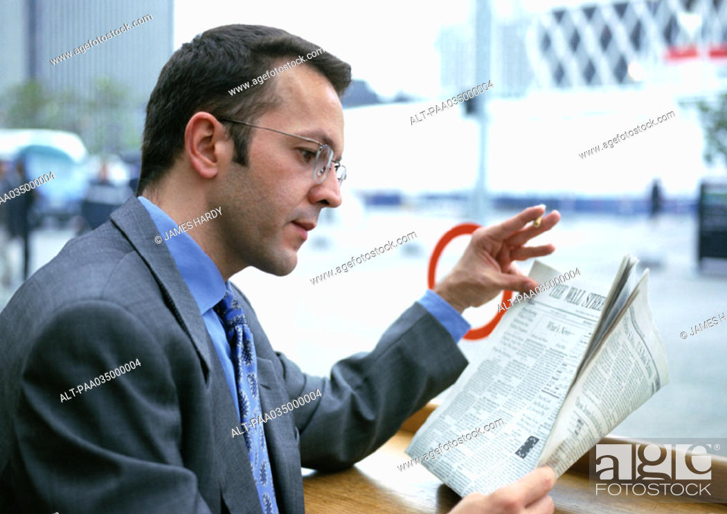 Stock Photo: Businessman reading newspaper.