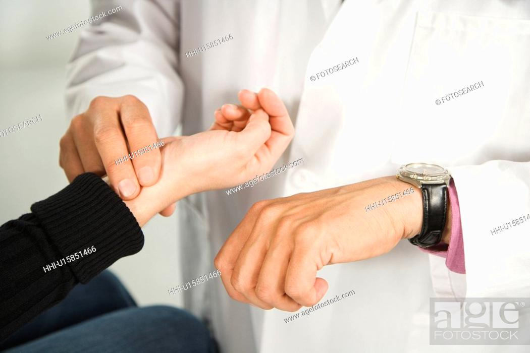 Stock Photo: Doctor taking patient's pulse.