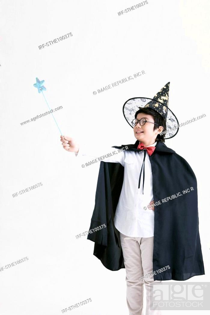 Stock Photo: boy holding a magic wand.