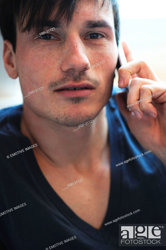Stock Photo: Young man using cell phone.