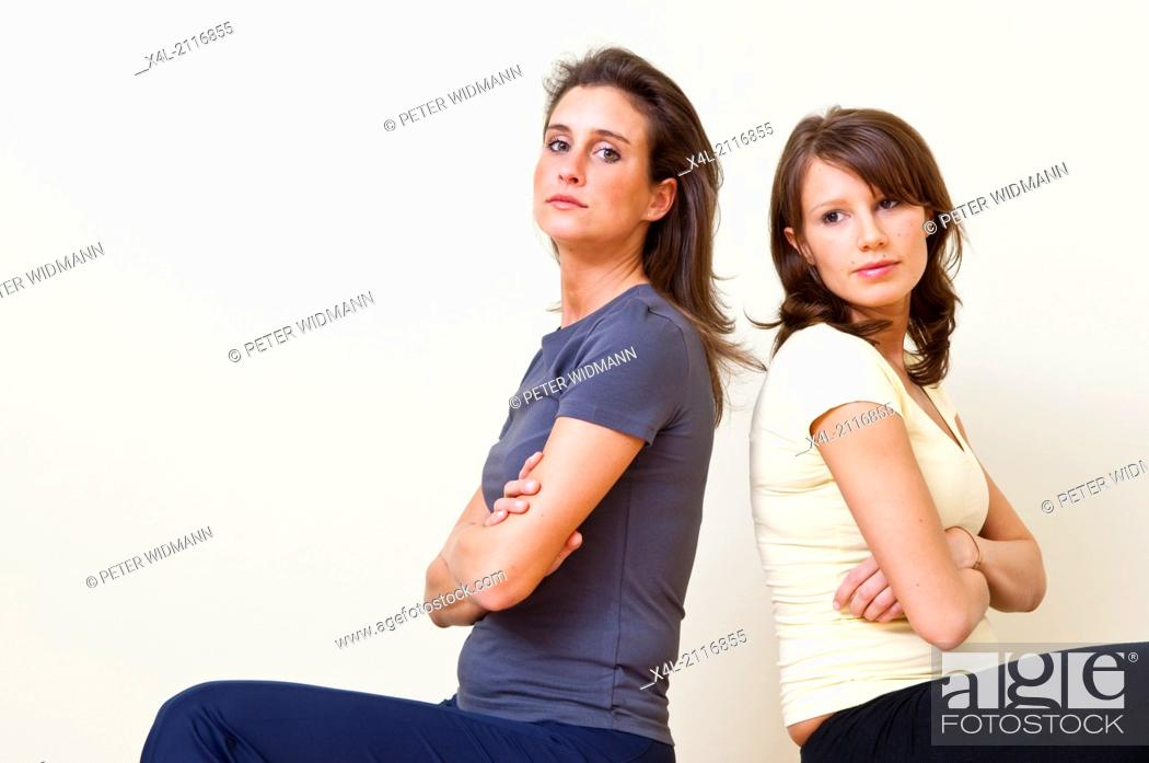 Stock Photo: two young women, quarreling (model-released).