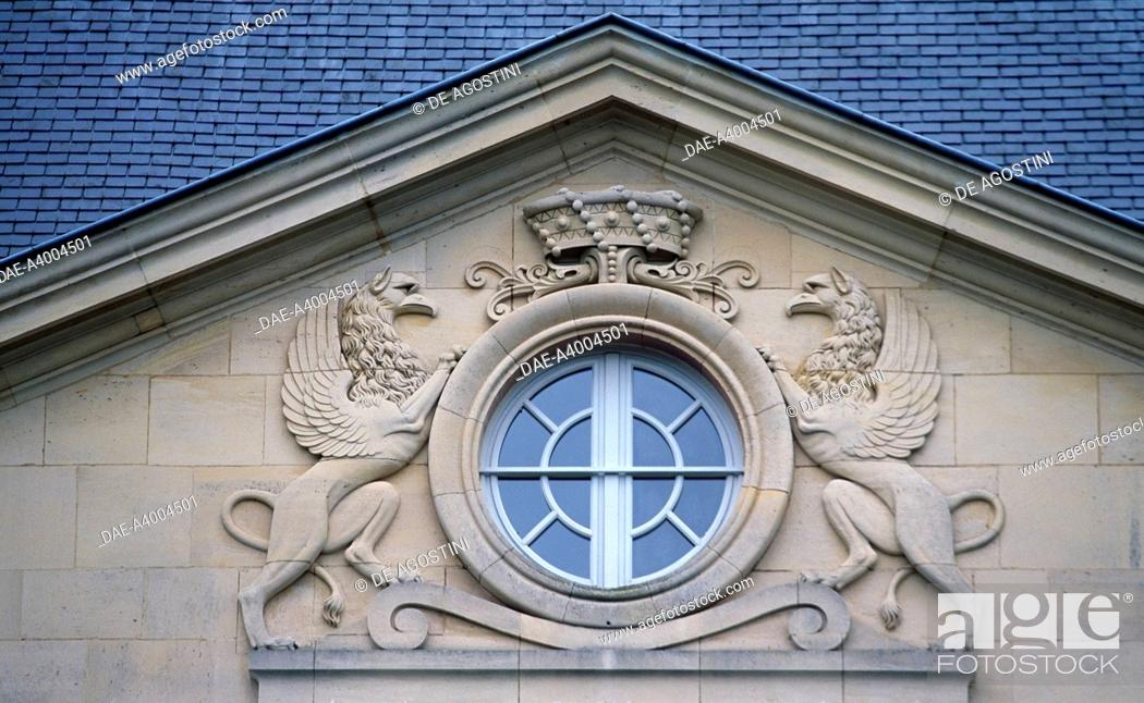 Stock Photo: Porthole with rampant lions, Louvois Castle (13th century), ancient abode of Michel Le Tellier, minister of Louis 14th, Champagne-Ardenne, France.