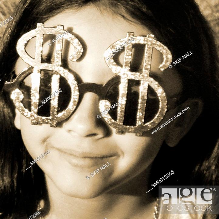 Stock Photo: Young girl wearing sunglasses the look like dollar sign.