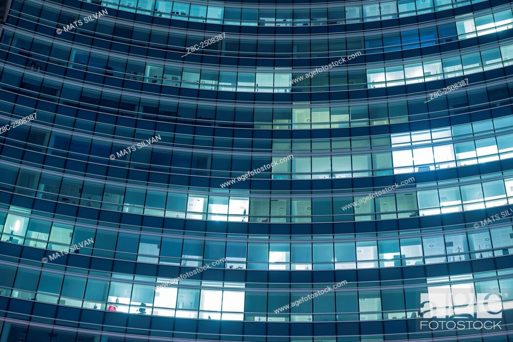 Stock Photo: Modern office building with illuminated windows at night in Milan, Italy.